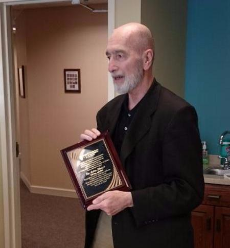 Board Honors Founding Member